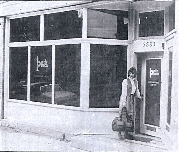 Woman standing in front of the original location of Birthplace, now called The Midwife Center.