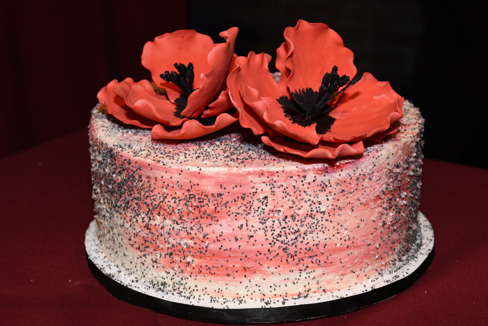 Cake with red flowers by Kaylie Carini of Hyeholde Restaurant